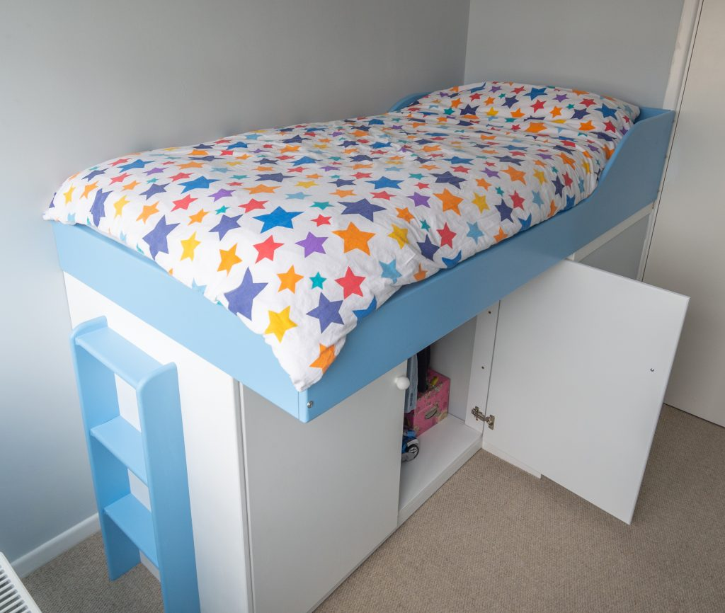 Cabin bed built over stair bulkhead